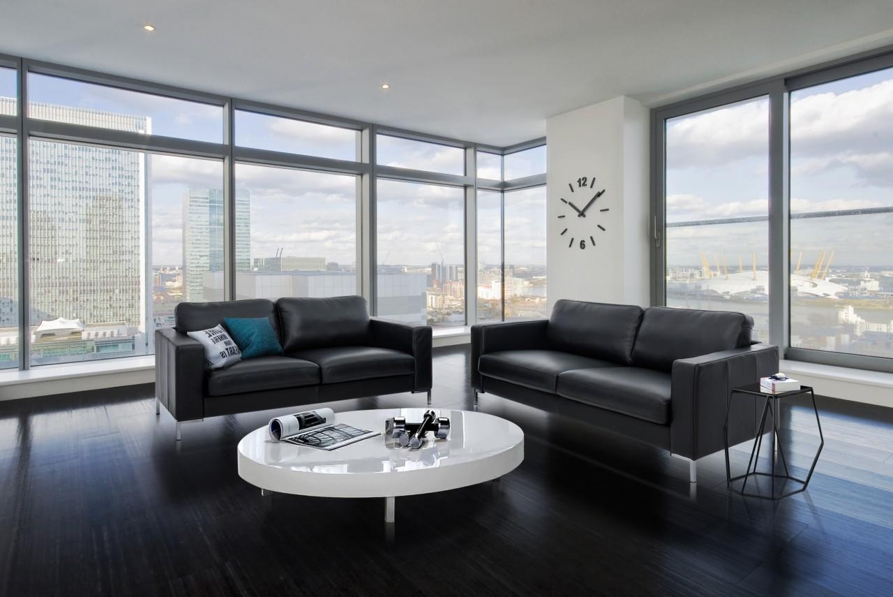 Ledersofa Liam elegant-zeitloses Designer Sofa in schwarz